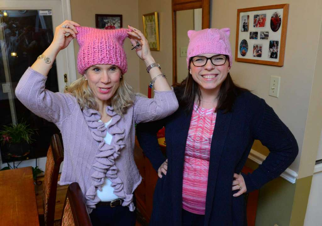 Heather Dean, left, shows the pussyhat she has knitted along with her friend Erin Lopez, for the upcoming Women's March on Washington D.C. on Saturday Jan. 21. The hats have been made for the Pussyhat Project, which many women are knitting for the march.