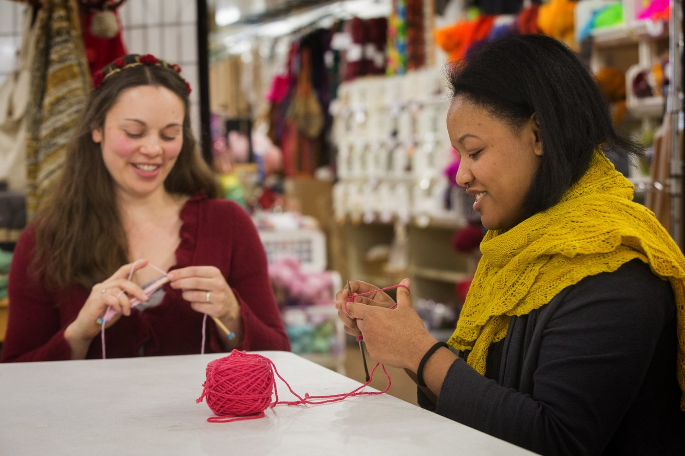 Jennifer Miller, left, a yarn wrangler, and Jessica Owens, manager of Weaving Works in Seattle, get started on knitting Pussyhats for women to wear at the Women's March on Washington. (Ellen M. Banner/The Seattle Times)
