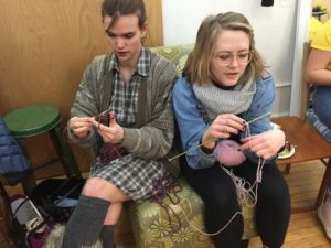Anna DeBraber (left) and Lauren Kuzee learning to cast on for the first time at a Craft Raft Studios hat-making event on Jan. 6, 2017.