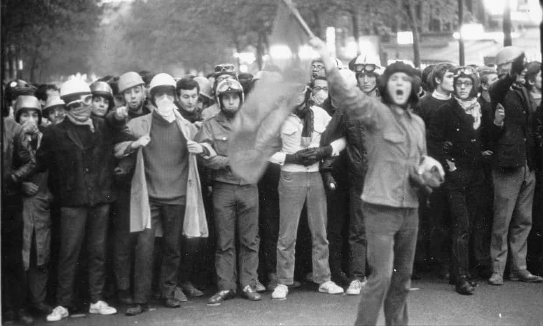 "<a href=""https://www.theguardian.com/fashion/2018/mar/25/fashion-world-50th-anniversary-paris-student-uprising"" target=""_blank"">The Guardian</a>"